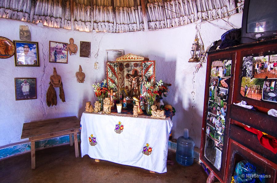 An alter with Catholic and Mayan figures